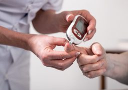 Nurse checking blood sugar level